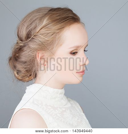 Cute Blonde Girl with Prom Hairstyle. Profile