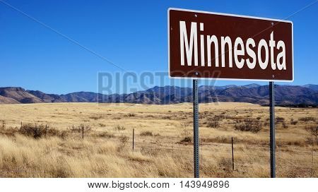 Minnesota road sign with blue sky and wilderness