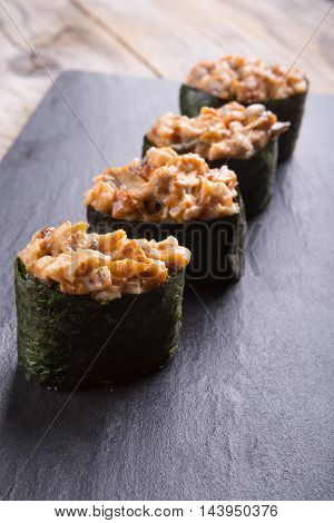 Traditional japanese gunkan with smoked fish fillet