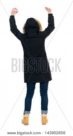 Back view of  woman.  Raised his fist up in victory sign.    Raised his fist up in victory sign.  Rear view people collection.  backside view of person.  Isolated over white background. Girl in warm