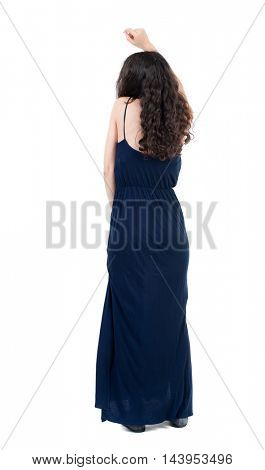 back view of dancing young beautiful  woman. girl  watching. Rear view people collection.  backside view of person.  Isolated over white background. The dark curly girl in a blue evening moves to the
