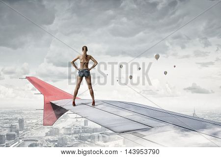Tourist on airplane wing . Mixed media