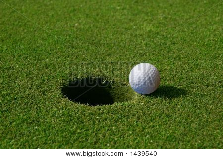 Golf Ball Entering Hole