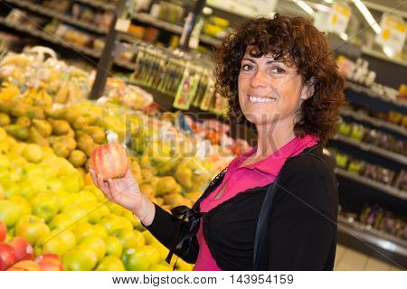 Lovely Woman Choosing Apple During Shopping At Fruit Vegetable Supermarket