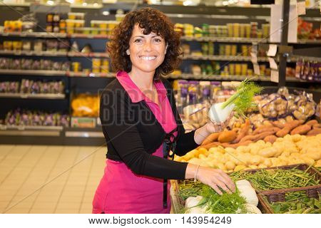 Brunette Woman Buying Vegetable On Stall At The Market