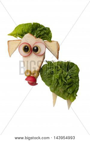 Funny sheep made of bread and vegetables on isolated background