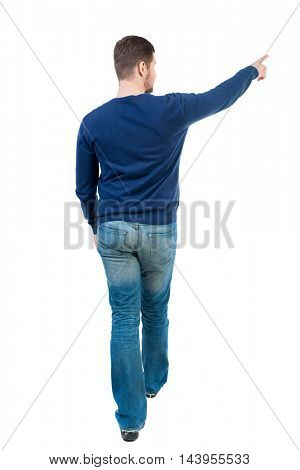 Back view of pointing business man.  Rear view people collection.  backside view of person.  Isolated over white background.  bearded man in blue pullover is pointing sideways.