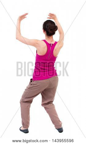 back view of woman  protects hands from what is falling from above. woMan holding a heavy load Rear view people collection.  backside view of person.  Isolated over white background. dark-skinned girl