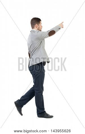 Back view of going  business man pointing. walking young guy . Rear view people collection.  backside view of person.  Isolated over white background. The bearded man in a gray jacket is pointing to