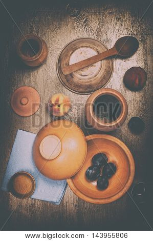 Vintage still life with dishes and fruit