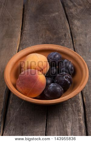 Ripe Fruit In A Ceramic Plate