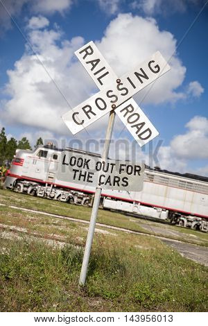 Rail road crossing sign on the train station outdoors.
