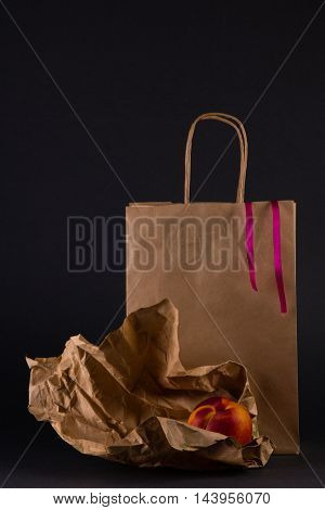 Still life with a package and a fresh peaches