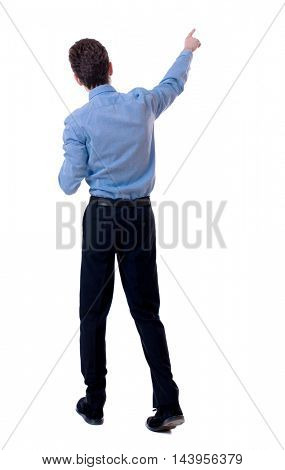 Back view of pointing business man.  Rear view people collection.  backside view of person.  Isolated over white background. Businessman in a blue shirt on the move points to something interesting.