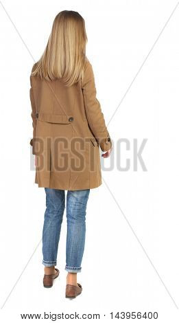 back view of standing young beautiful  woman.  girl  watching. Rear view people collection.  backside view of person. The blonde in a brown cloak, standing and looking forward.