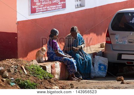 Coonoor , Tamil Nadu, India, March 22, 2015: Two women talking on the street. Friendship chatting concept Indian culture