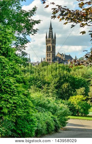 Glasgow University tower from Kelvingrove Park in summer.