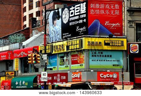 New York City - July 26 2013: Shops with signs in English and Chinese line the streets of Chinatown in Flushing (Queens)