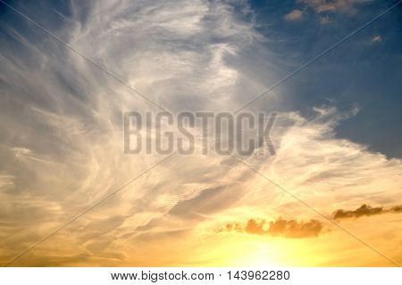 Beautiful colorful celestial sunset with white clouds high in the stratosphere in the evening. horizontal view