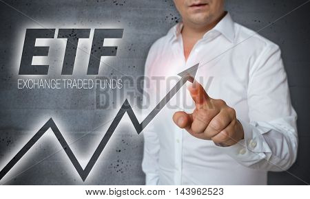 etf touchscreen is operated by man picture