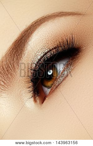 Perfect Shape Of Eyebrows, Brown Eyeshadows And Long Eyelashes.