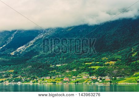 Scandinavian Village On Shore Of Hardangerfjord. The Hardangerfjord Is The Fourth Longest Fjord In The World, And The Second Longest Fjord In Norway.