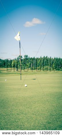 Golf ball and green in prince edward island