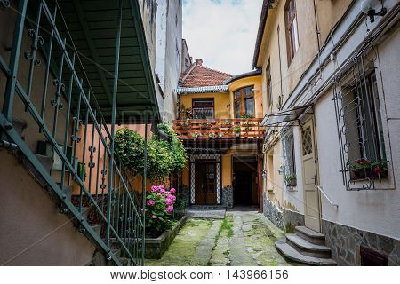 Courtyard of small tenement houses in Brasov city in Romania