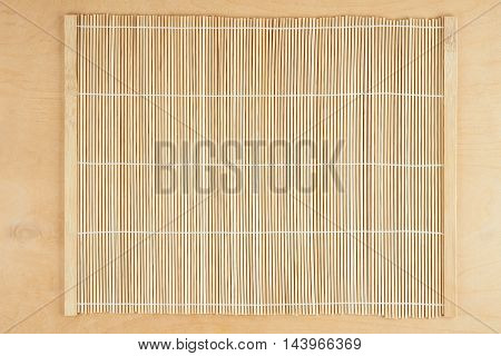 Beige bamboo napkin scattered on wooden table
