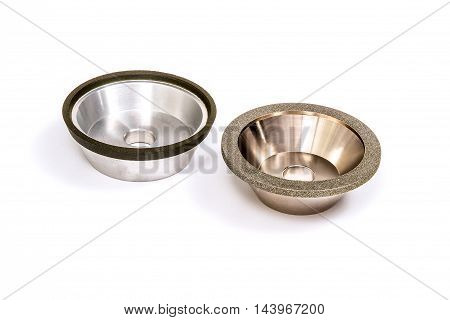 Industrial grinding and polishing wheels on white background