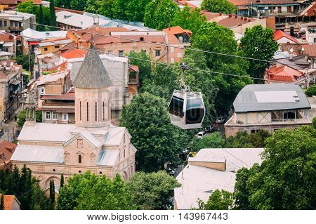 Top View Of Jvaris Mama Ancient Georgian Christian Church And Moving Car Of Cableway Under Old Part Of Summer Tbilisi, Georgia