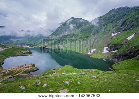 Balea Lake next to Transfagarasan Road in southern section of Carpathian Mountains in Romania