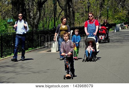 New York City - April 27 2013: Parents with their children walking in Riverside Park on a warm Spring afternoon