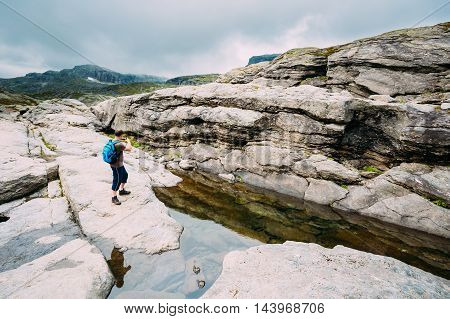 Tourist Young Man Photographs Beautiful Landscape Of Norwegian Mountains. Nature Of Norway. Travel And Hiking. Active Lifestyle. Amazing Scenic View. Scandinavia Travel.