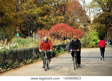 New York City - November 6 2006: People riding bicycles in Riverside Park on an Autumn afternoon