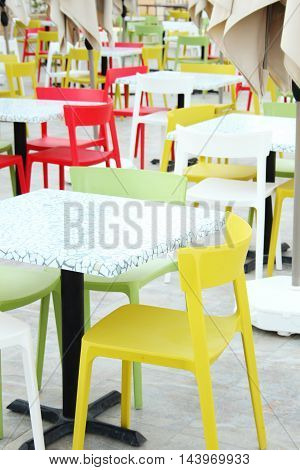 Colourful tables and chairs in a cafe.