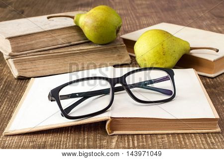 Still life with books glasses and pears