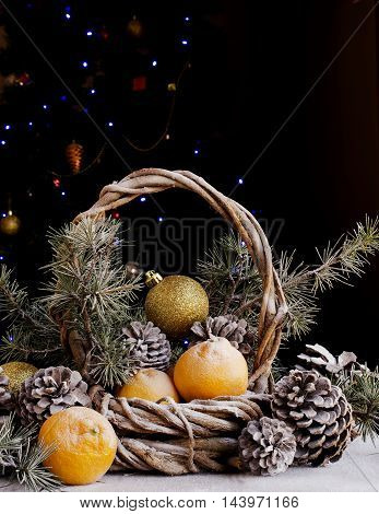 Christmas card with fir branches, tangerines, pine cones, and decoration elements , selective focus