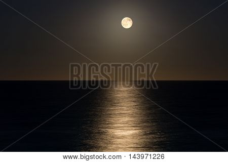 image of the Moon over the ocean