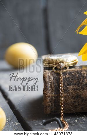 easter egg with happy easter word and gold pocket watch