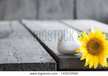 heart on a wooden table, background for greeting card