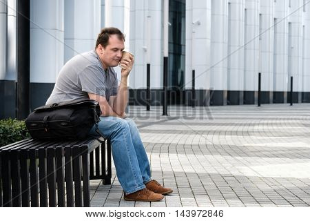 Sad headache middle age man portrait outdoors