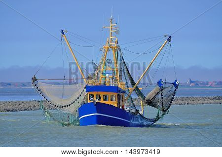 Crab Fishing Trawler at wadden Sea near Greetsiel in East Frisia, North Sea, Lower saxony, Germany