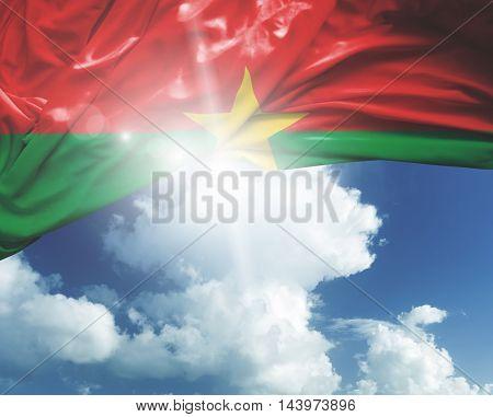 Burkina Faso flag on a beautiful day