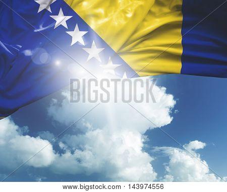 Bosnia and Herzegovina flag on a beautiful day