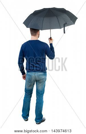 young man in in a white knit sweater under an umbrella. Rear view people collection.  backside view of person.  Isolated over white background. bearded man in blue pullover standing under an umbrella.