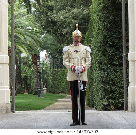 ROME ITALY - CIRCA JULY 2016: unidentified presidential guard at the entrance of the Quirinale Palace (official residence of the president of the Republic of Italy)