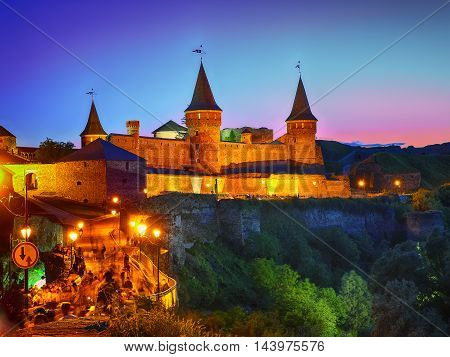 Castle at a moonlight night. Illuminationed castle. Kamenets-podolsky. Ukraine