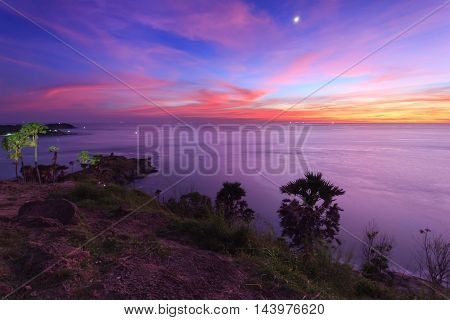 Beautiful sunset in promthep cape is a mountain of rock that extends into the sea in Phuket Thailand