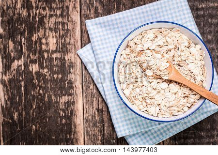 Oat Flakes On Wooden Table.healthy Food Concept.